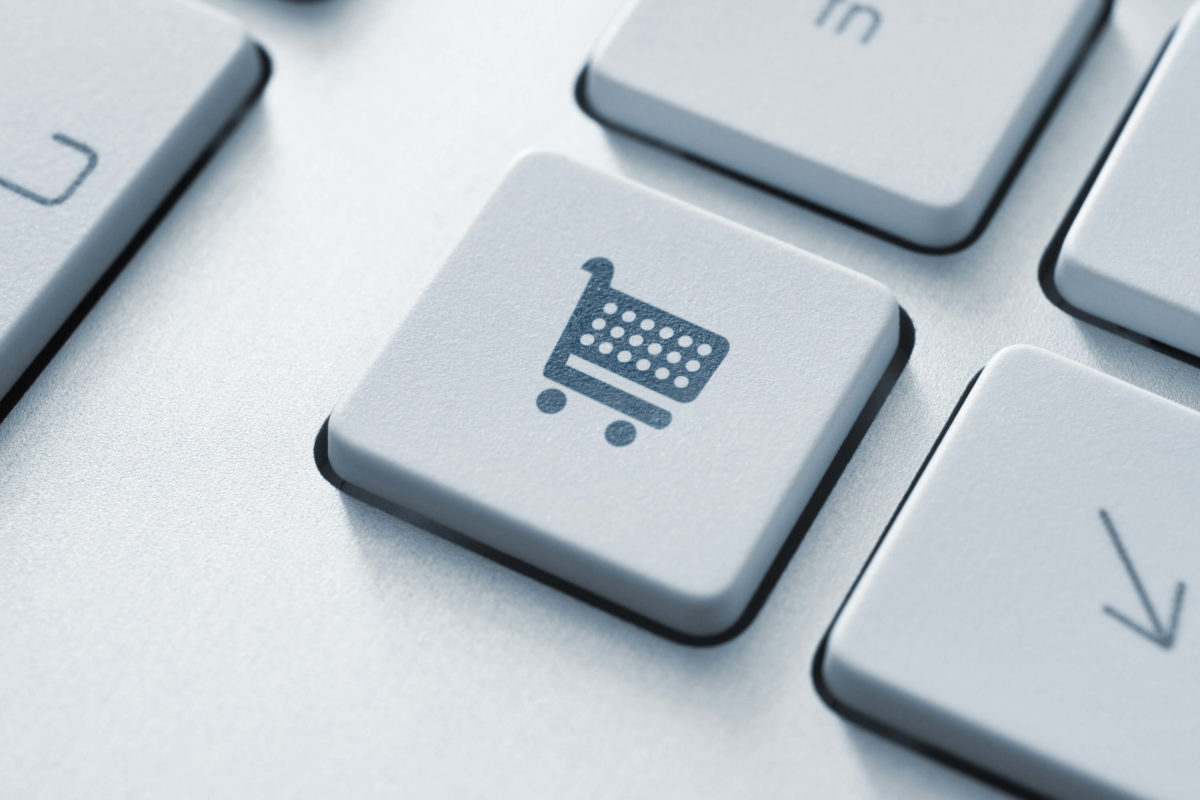 Keyboard with shopping cart button showing how to write a holiday gift guide